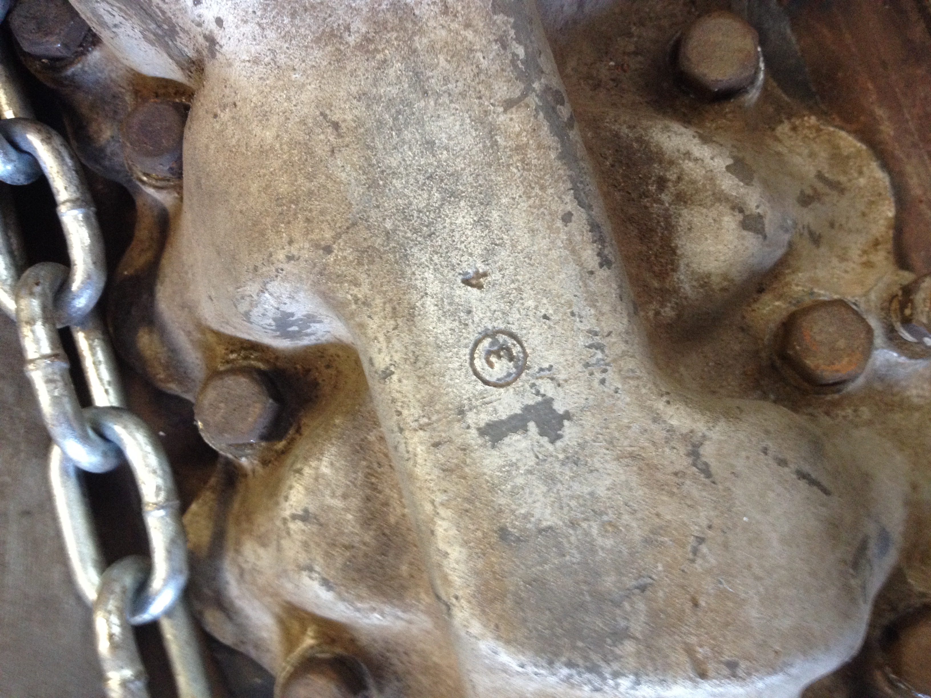 The only stamping that I can see in the intake manifold.